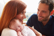 stock-photo-46763406-parents-at-home-with-sleeping-newborn-baby-daughter
